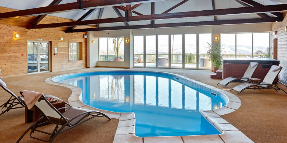 Indoor heated pool with hot-tub, sun terrace and stunning views