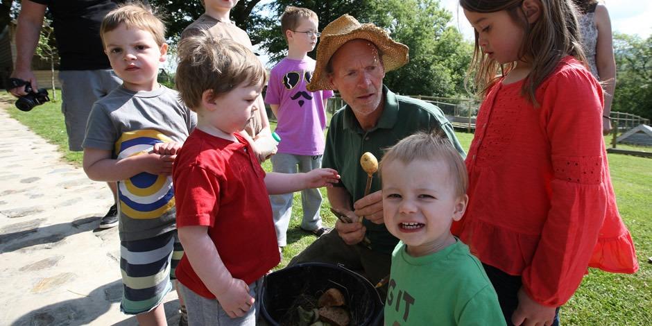 Farmer Malcolm & children getting ready to feed