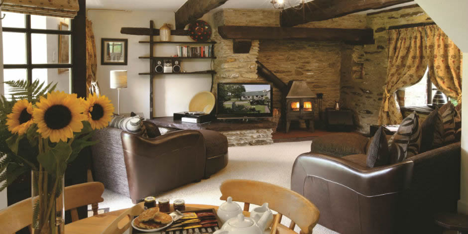 Spacious sitting rooms with log burning stoves